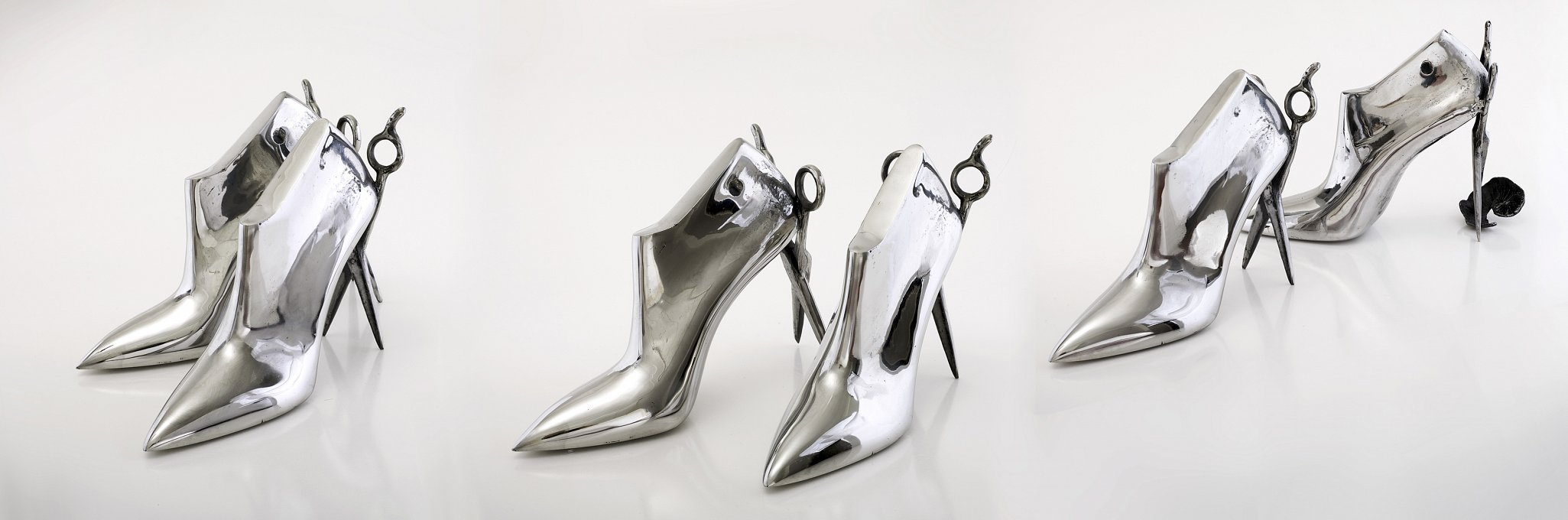 Catwalk Three pairs of cast stainless steel shoes with scissor heels